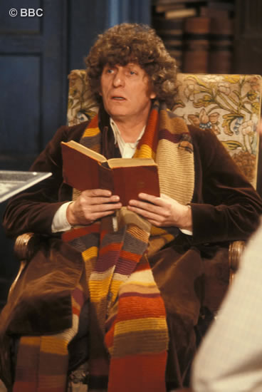 Tom as the Doctor reads the Ancient Law of Gallifrey book.  Picture © BBC