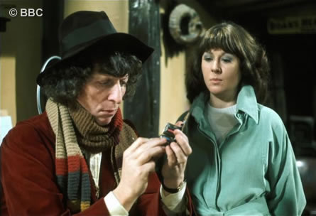 Tom as the Doctor examines a piece of equipment  watched by Elisabeth Sladen as Sarah Jane Smith.   Picture © BBC